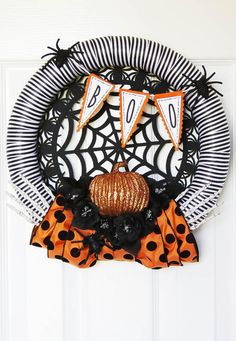 Spooky Spiders Halloween Wreath - This cute new wreath is all decorated with spiders and flowers - and some peeking little skeleton hands too!