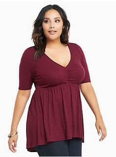 "This merlot red ribbed knit top has that coveted stretchy-yet-clingy fit and feel aka it's just as comfy as it is flattering. A babydoll cut hides any tummy issues, while the cinched bodice transforms your cleavage.<div><br></div><div><b>Model is 5'10"", size 1<br></b><div><ul><li style=""LIST-STYLE-POSITION: outside !important; LIST-STYLE-TYPE: disc !important"">Size 1 measures 27 3/4"" from shoulder</li><li style=""LIST-STYLE-POSITION: outside !important; LIST-STYLE-TYPE: disc !impo..."
