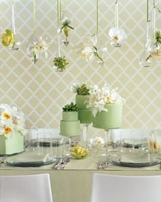 Setting vivid (and long-lasting) orchids against spring-green fondant-covered tiers results in a look that's fresh and utterly modern. There are hundreds of orchids to choose from; we used (from left) cattleya, dendrobium, lady's slipper, and 'Japhet' cattleya.
