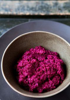 Colorful beet hummus made with cooked red beets, sesame seed tahini paste, lemon juice, garlic, and cumin.