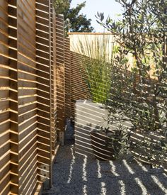 A key aspect of the renovation was ensuring the privacy of the resident, whose frontyard formerly exposed the home to the road. At five f...