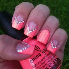 bright neon color tip with rhinestones. It'd be better if the cuticles were cleaned up.