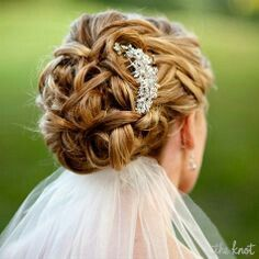 Wedding updo with hair piece and veil underneath
