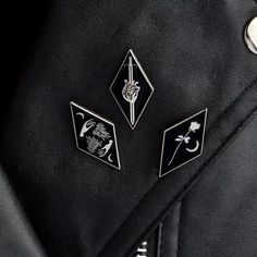 Want to add some minimal punk rock chic to an outfit? This trio of low key gothic enamel pins is a must add!