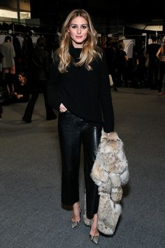 Olivia Palermo in all black with furry coat