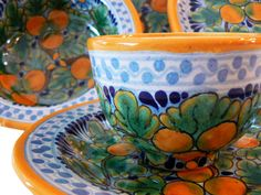 The vibrant, sunny Naranja Talavera pottery collection of dinner plates, tableware, settings, home décor and gifts is just what you need to add vibrant warmth to your home.