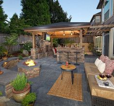Covered outdoor patio kitchen & open outdoor living room with curved stone bench & fire pit. ~ 99 Amazing Outdoor Fireplace Designs Ever. ~ http://mycoolgardenn.com/cool-99-amazing-outdoor-fireplace-design-ever-www-99architectur/