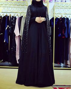 Why is hijab clothing expensive? Hijab Style Dress, Modest Fashion Hijab, Modern Hijab Fashion, Fashion Dresses, New Abaya Style, Kaftan Style, Hijab Chic, Burqa Fashion, Muslim Women Fashion