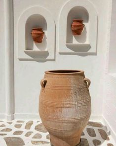Loving this inspo for an outdoor feature. Would you try something like this at home?⠀ ⠀ #twogingerspades #rusticmediterranean #tgs #inspiredliving #interiordesign #vases #mediterranean #featuredesign #wallfeature #outdoorfeature #pottery Ceramic Pots, Flower Pots, Flowers, The Hamptons, Planter Pots, Pottery, Backyard, Rustic, Interior Design