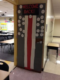 Ohio State football helmet inspired door decoration. My students' names are on the door in the same way that the Ohio State Buckeyes' helmet stickers are on the helmets.