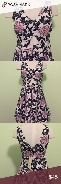 """NWT Topshop floral dress NWT Fun and flirty sleeveless dress from Topshop. Keyhole in front. Deep v in back. Pleated skirt. Soft pink and black floral print on off white background. Zipper in back. 100% polyester. Bust: 16"""". Waist: 13"""". Length: 34"""". Topshop Dresses"""