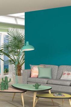 Une teinte turquoise pour réveiller les murs du salon