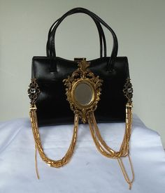 Black leather# handbag# vintage# gold chains# mirror# brass and rhinestones