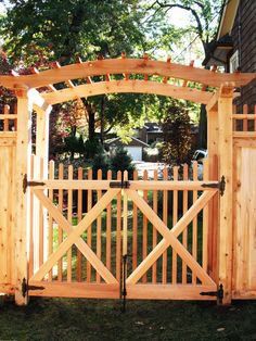 wood arched top pergola with spindle gates