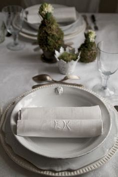 table settings ; monogramed linen napkins....moss covered hyacinth bulbs