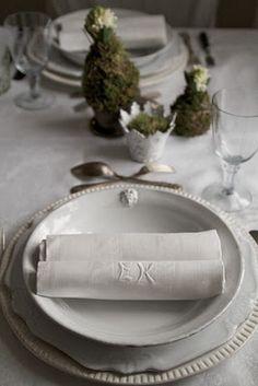 table settings ; monogramed linen napkins....moss covered hyacinth bulbs