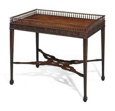 A George III mahogany silver table with lovely blind fretwork