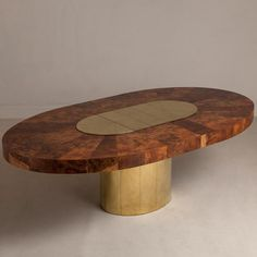 Paul Evans; Burl Wood and Brass 'Cityscape' Dining Table for Directional, 1970s.