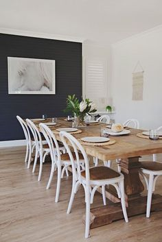 But how to apply color to your living room? Today we will cover the 2 most contrasting colours to décor your Luxury Dining Room with: white and black. Luxury Dining Room, Dining Room Design, Dining Room Furniture, Dining Room Table, Furniture Design, White Wood Dining Chairs, Dining Room Feature Wall, Coastal Furniture, White Chairs