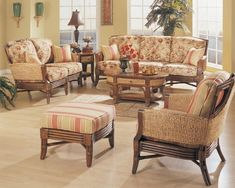Hazelton Rattan Wicker Furniture Set -  Impressive by design, the Hazelton furniture set is a mix of tropical character and traditional structure. Rattan cane adds visual interest along with wood components that lend a lustrous finish while highlighting distinctive curves and gentle tapers. The chair, sofa and loveseat, along with an oval coffee table and end table are softened with classic wicker insets crafted from natural abaca banana palm fibers.