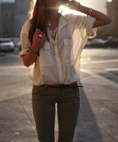 Army green pants and white sheer blouse
