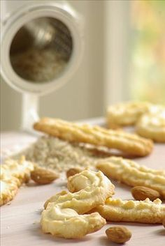 Mandelspritzgebäck ~ (German Almond Spritz Cookies) I can't remember a single holiday season without these typical German cookies. My Mutti always baked these cookies. As a child I helped dip the ends of the cookies in melted chocolate. German Christmas Cookies, German Cookies, Holiday Cookies, German Christmas Traditions, Spritz Cookies, Galletas Cookies, Holiday Baking, Christmas Baking, German Desserts