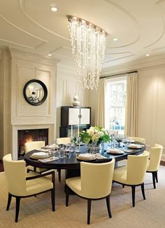 Elegant Furniture, A Stylish Chandelier, An Eye Grabbing Piece Of Wall  Art...A Sophisticated Formal Dining Room With A Distinctive Architectural U2026