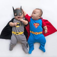 Baby twins dressed in VERY cute outfits.
