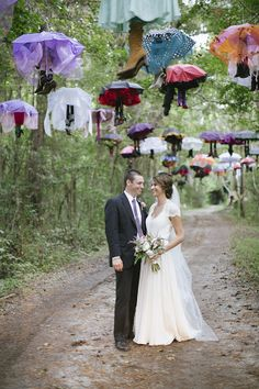 hanging umbrellas with shoes as wedding ceremony entrance decor #weddingceremony #decor #diy http://www.weddingchicks.com/2014/01/21/good-mood-metallic-wedding/