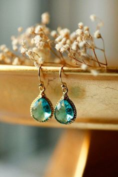 Bring a little summer back into your life. These earrings remind us of the bright, blue crystal waters of the ocean!