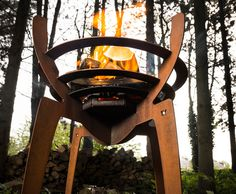 "Inspired by the shape and movement of a spider and ancient storytelling, signs, and symbols, ""FIREWALKWITHME"" is a portable knockdown fire basket made of corten steel by designer Nik Baeyens."