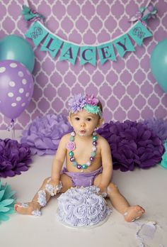 Shabby chic and darling in purple, turquoise, & teal for baby girl's first birthday outfit and cake.