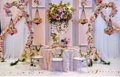 Hanging wrought iron trimmed with flowers defining an opulent sweetheart table Cake Table Decorations, Reception Decorations, Event Decor, Flower Decorations, Wedding Name, Diy Wedding, Dream Wedding, Wedding Trends, Wedding Designs