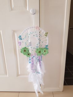 Dreamcatcher - weaving, flowers, beadwork, feathers and ribbons. Very diverse.