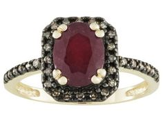 1.45ct Oval Mahaleo(R) Ruby With .15ctw Round Champagne Diamond 10k Yellow Gold Ring