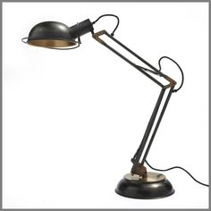 Inspired by a classic 1930s British task lamp whose designer specialized in vehicle suspension systems, ours is a faithful reproduction. Crafted to the highest standards and finished with antique bronze and brass, it is fitted with tension-spring supports developed in the last century and refined over decades. Adjustable positioning of arms allows for the ultimate focus.