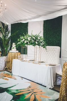 Wow, what a success!! The Prime Time Bridal Open House was amazing. We were able to collaborate with Unlimited Events for this beautiful installation. The three boxwood hedge panels were flanked with beautiful white molded walls. The head table sat in front with a custom designed dance floor by Maria Gossard Designs.