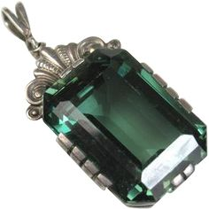 This is fine Art Deco era pendant with a simple setting in silver framing a superb rectangular spinel stone. The faceted stone is blue green to Art Deco Jewelry, Pendant Jewelry, Gemstone Jewelry, Silver Jewelry, Fine Jewelry, Jewellery, Antique Rings, Antique Jewelry, Vintage Jewelry