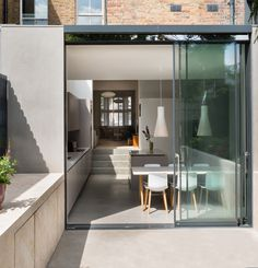 Polished Concrete Floor Lazenby's Light Natural polished concrete floor and cast in-situ flight of concrete steps joins the Victorian property to a contemporary split-level extension.