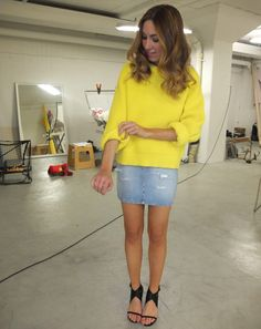 Wearing neon sweater + denim mini skirt