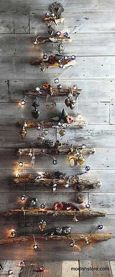 graduated lengths of driftwood are mounted on the wall to compose this holiday tree the