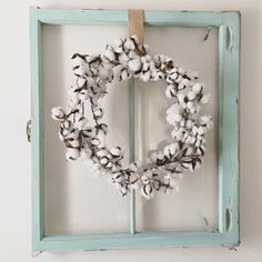 Cotton wreath and old window