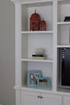 Alison Royer of Belmon Design Group filled this bookcase with Casablanca Lanterns, Gelato frames and flora tealights.