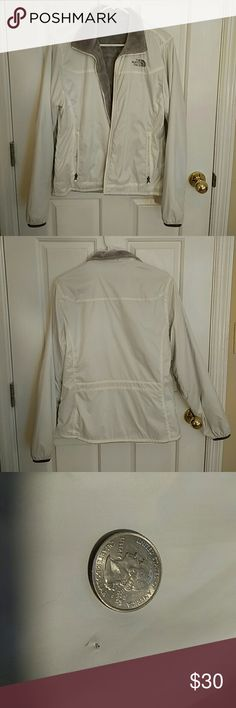 The North Face White Fleece + Wind Breaker This is a The North Face fleece jacket all white with grey fleece interior and sleeve trim. It's a size small. I used it once because I didn't like the fit. The outer layer is a light wind breaker material. It picked up a few micro-holes in the outer layer between moves and I photoed as many as I could. The biggest one (second photo) is under the arm right on the seam and can definitely be fixed. Let me know if you have any questions. The North Face…