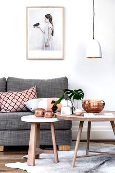 Modern white living room with rose gold accents and gorgeous artwork | The Next Big Interior Décor Trends to Watch 2015