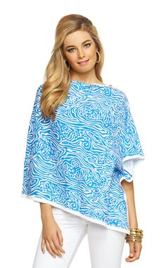 The Harp Wrap is the ultimate plane outfit. Simply add your favorite pants and cotton shirt and throw on for an easy and cozy look. This cotton poncho is simply the best - printed, soft and classic Lilly.