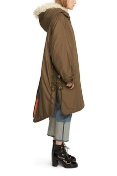 Exaggerated filled fishtail parka with shearling hood trimLightweight filled…
