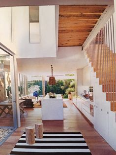 Love this open plan with the kitchen under the stairs