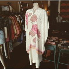 "Vintage creamy white floral kaftan accesorised with a House of Skye dusty pink ""daisy row bolo tie"""