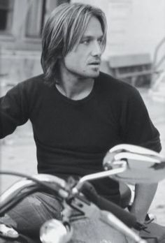 Keith Urban Riding on a Harley! :)